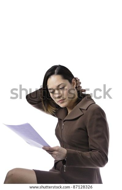Mixed race female has her hand in her hair is wearing a business suit. This has a clipping path.