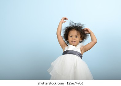 Mixed race girl holding up her arms