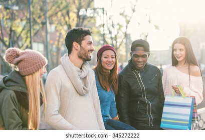 Mixed race group of friends having fun outdoor. concept about people, friendship and autumn