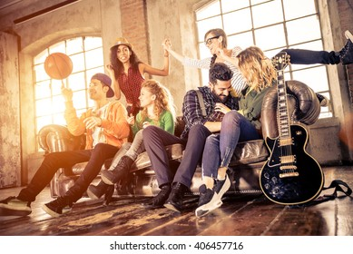 Mixed race group of teenagers having fun on the couch