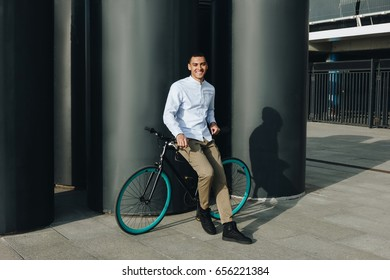 Mixed race hipster man  with bicycle in the city