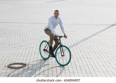 Mixed race hipster man riding a bicycle in the city