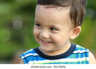 mixed race kid smiling in the garden