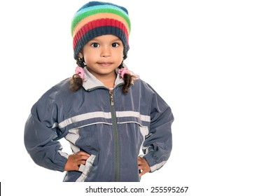 Mixed race little girl wearing a colorful beanie hat and a jacket isolated on white
