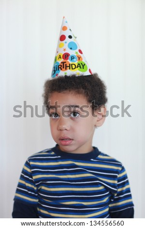 Mixed Race Toddler Boy With Birthday Hat
