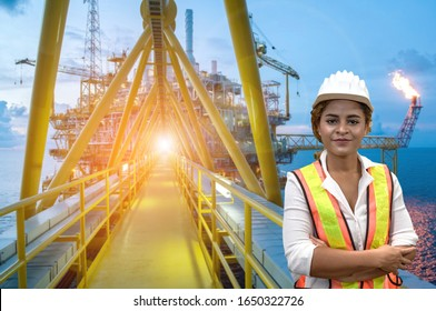 mixed race woman engineer staff worker and offshore rig background concept.