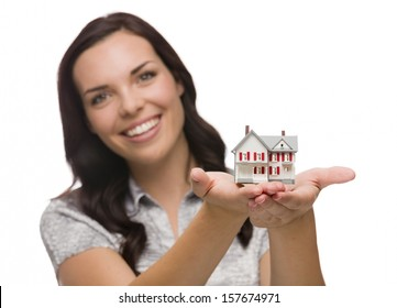 Mixed Race Woman Holding Small House Isolated on White Background - Focus is On The House.
