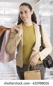 Mixed race woman shopping and carrying shopping bags
