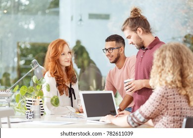 Mixed race workers brainstorming at the advertising agency business office