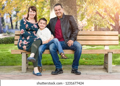 Mixed Race Young Family Portrait At The Park.