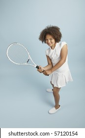 Mixed race young tennis girl ready to play