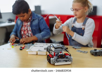 Mixed Racial group of School kids sitting at class with diy robot, stem education concept.