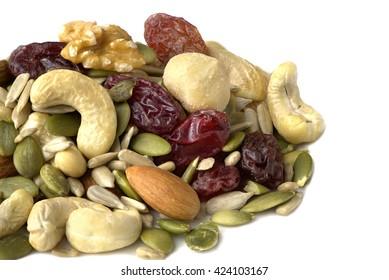 mixed raw nut and fruit isolated on white background