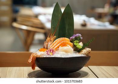 Mixed Raw Seafood Sashimi Set - Fresh salmon sliced, Fresh amaebi (Sweet shrimp) and Hotate (Scallop) served on ice with wasabi, Food Japanese Style.