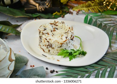 Mixed rice garnish on white plate with decorated background Restaurant Food,Restaurant Menu