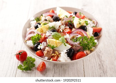mixed rice salad with egg, tomato, olive