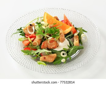 Mixed salad with pieces of pan roasted chicken