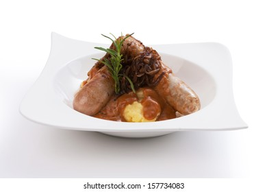 Mixed Sausages Grilled in white bowl isolated on white.