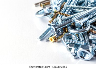 Mixed screws and nails. Industrial background. Home improvement.bolts and nuts.Close-up of various screws. Use for background, top view.