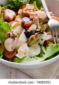 mixed seafood salad with mozzarella and avocado