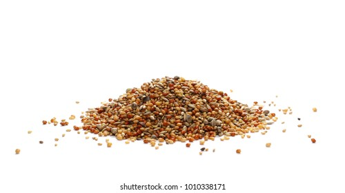 Mixed seeds, millet pile for exotic birds, finches with hemp isolated on white background