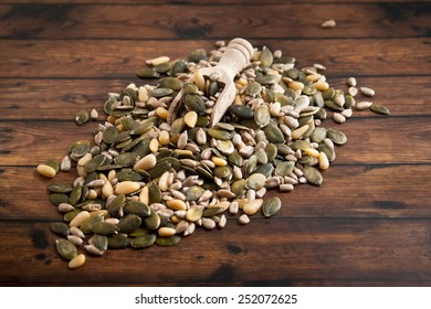 mixed seeds over wooden background