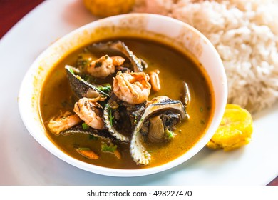 """Mixed shell and shrimp, """"Encocado"""" seafood stew with coconut."""