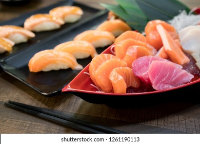Mixed sliced fish sashimi on ice in white bowl. Sashimi Salmon Tuna Hamachi set, raw fish, japanese food in Asian restuarant.