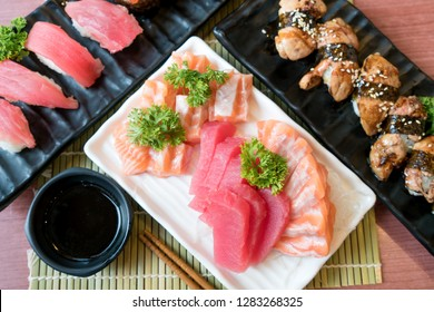 Mixed sliced fish sashimi in white plate. Sashimi Salmon and Tuna set with Tuna, flying fish roe caviar and Foie Gras closeup. Japan restaurant menu