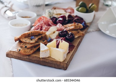 Mixed snack - nuts, honey, cheese, olives. Various appetizer served with vine