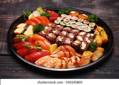 Mixed sushi roll and sashimi platter