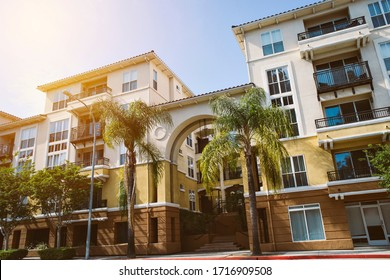 Mixed use commercial real estate building with apartments and business office - Palm Tree and Sky - Real Estate Class A