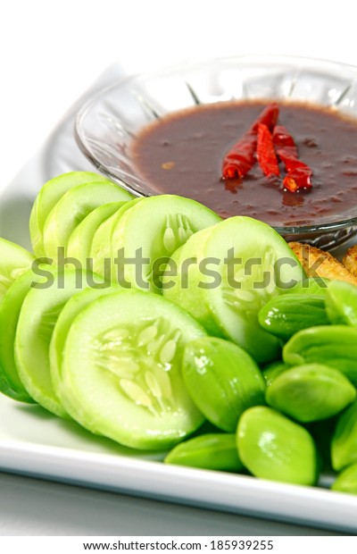 Mixed vegetable menu with sliced cucumber and fresh stink beans mostly served with Shrimp-paste sauce in Thai food menu.