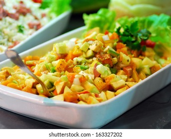 mixed vegetables dish with green salad in restaurant buffet