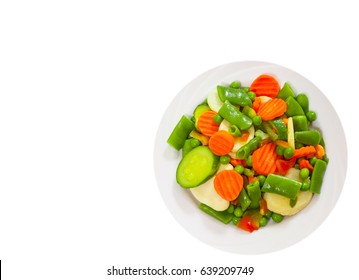 Mixed vegetables on a plate. top view. isolated on white