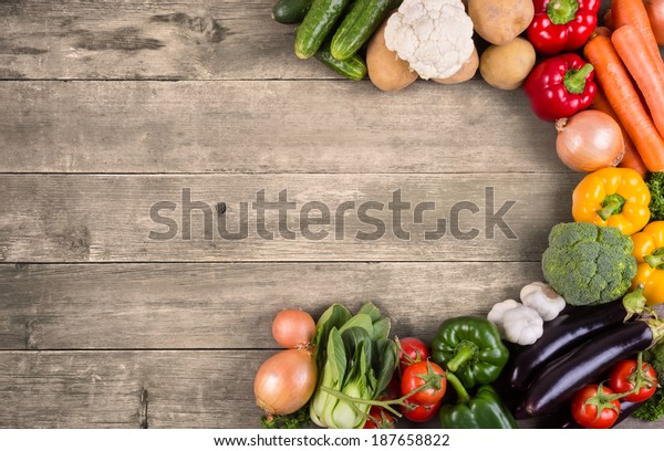 Mixed vegetables on wooden table top view. Organic food from farm.