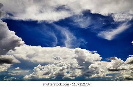 Mixed white cloud formations against a blue sky