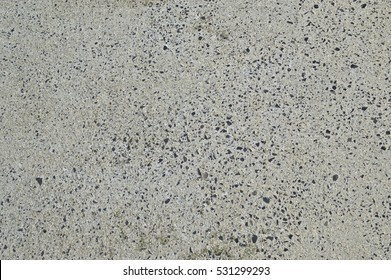 Mixed white Concrete with black stones, roadway pavement surface. Grey flat texture for 3D work, textured backround