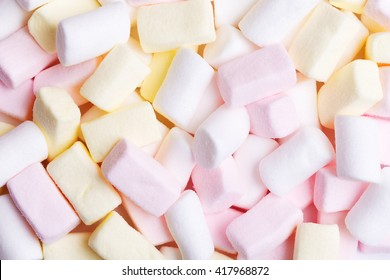 Mixed white, pink and yellow marshmallows as background