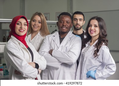 Mixed-race group of young workers are working in biochemistry lab, portraits of lab technicians