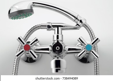 Mixer cold hot water on a white background. shower head. Chrome plated metal.