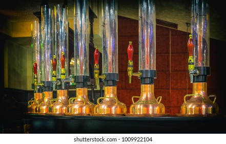 A mixer and a glass tube for draft beer in a modern bar. beer dispenser, close-up, selective focus, retro style