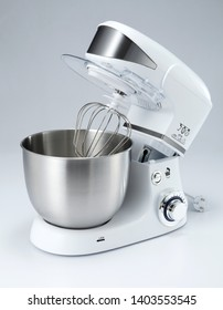 "A mixer, hand mixer or stand mixer, is a kitchen device that uses a gear-driven mechanism to rotate a set of ""beaters"" in a bowl containing the food or liquids to be prepared by mixing them."