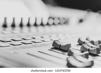 mixing console fader, black and white. music production, recording, broadcasting concept