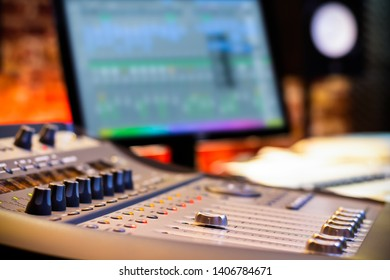 mixing console fader on computer monitor background in recording, broadcasting, editing studio. post production concept