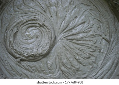 Mixing of dry building mixes with mixers. Wet mortar mixture for finishing work in construction. Traces of rotation of the tool, prints on cement. Close-up