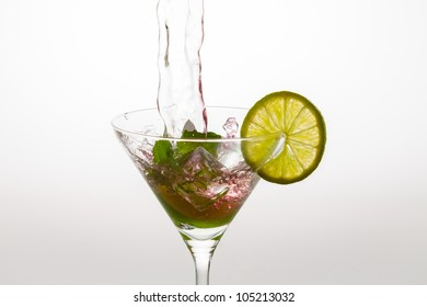 Mixing liquors in a cocktail glass