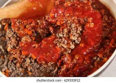 Mixing tomato paste and minced meat. Making Lasagna Bolognese Series.