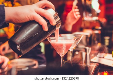 Mixologist making cocktail