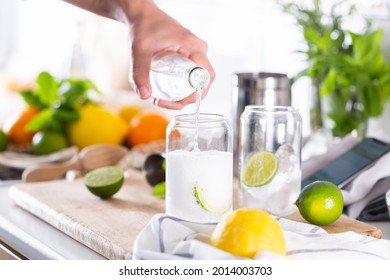 Mixologist making refreshing cocktail with hard seltzer at home